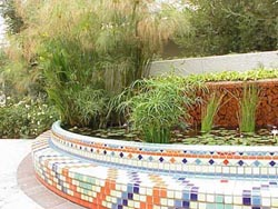 Mosaic tile covered concrete pond